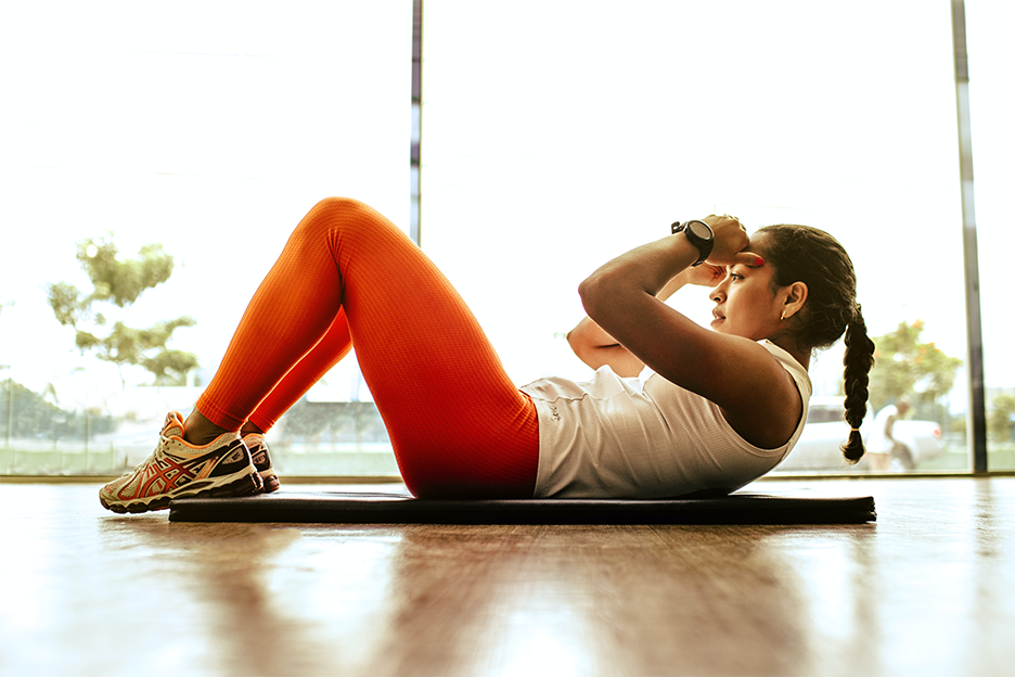 Image of a woman exercising at home on a yoga mat